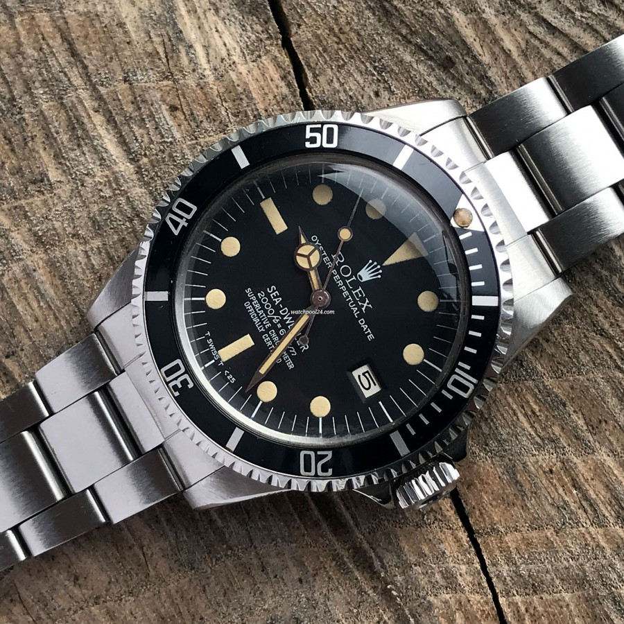Rolex Sea-Dweller 1665 Rail Dial - Box and Papers - black rotating bezel is perfect