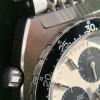 Heuer Autavia 73663 Siffert Color - schwarze drehbare Lünette mit Stunden- und Minutenmarkierungen
