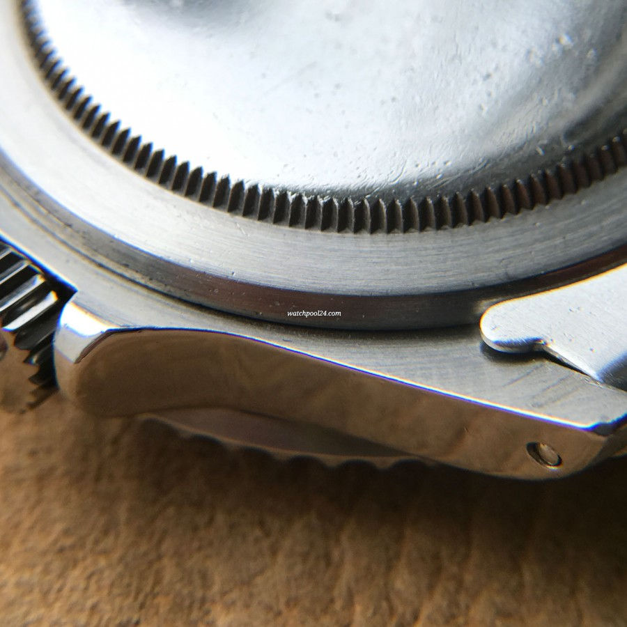 Rolex Submariner 5513 Punched Papers - sharp lines and curves