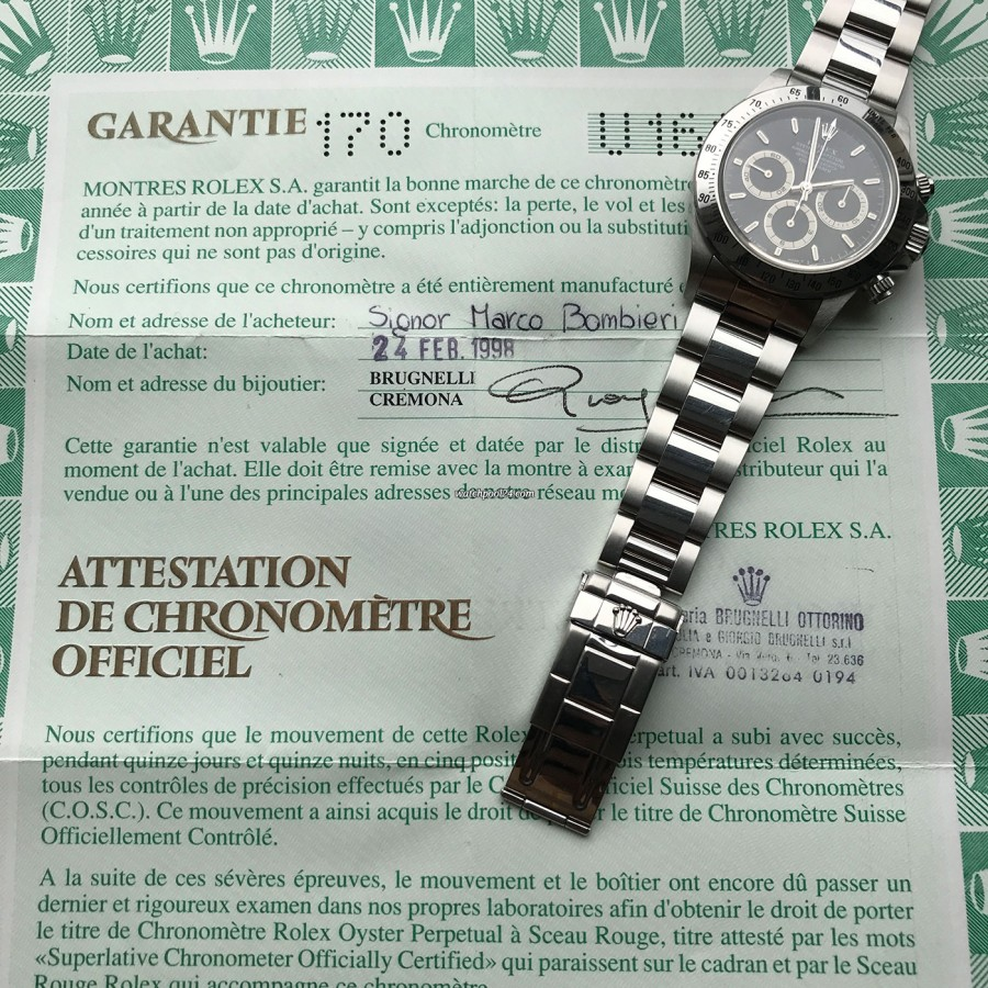 Rolex Daytona 16520 NOS Full Set - gelochter Chronometer-Garantieschein